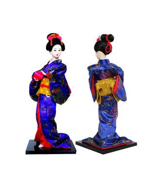 Japanese souvenir of  geisha doll in kimono dress with ball on hand,