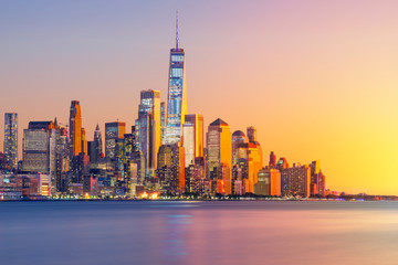 Foto op Plexiglas New York a magnificent view of Lower Manhattan and the financial district at sunset, New York City