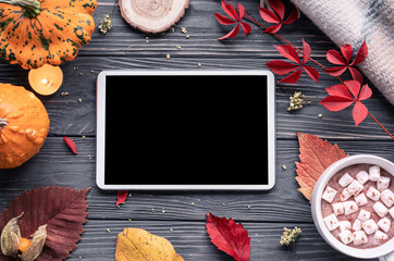 Autumn fall holiday background with pumpkin orange leaves cocoa cup tablet computer blank empty screen mock up on brown wooden table, happy halloween thanksgiving shopping sale, above top view Wall mural