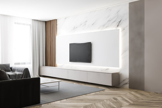 Luxury white marble living room with TV and sofa
