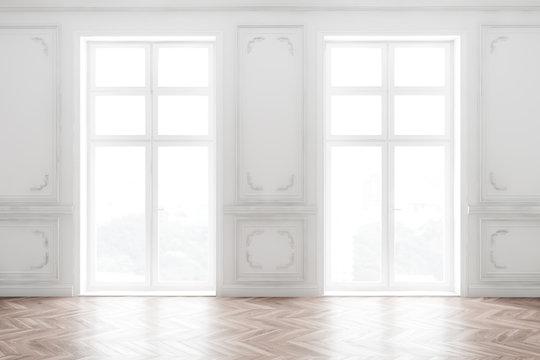 Empty white room interior with windows