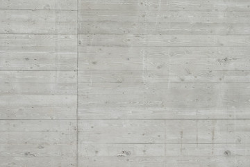 Concrete surface with wooden planks texture, with a pronounced element