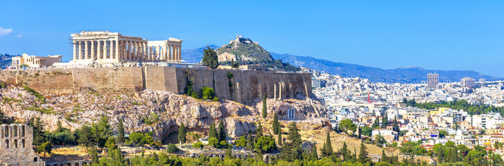 Poster Athens Panoramic view of Athens, Greece. Famous Acropolis hill rises above cityscape. It is top landmark of Athens. Landscape of old Athens city with Ancient Greek ruins. Skyline of Athens in summer.