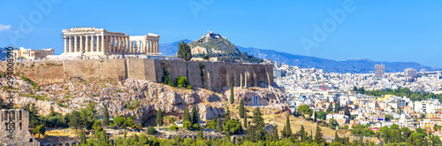 Fototapete Panoramic view of Athens, Greece. Famous Acropolis hill rises above cityscape. It is top landmark of Athens. Landscape of old Athens city with Ancient Greek ruins. Skyline of Athens in summer.