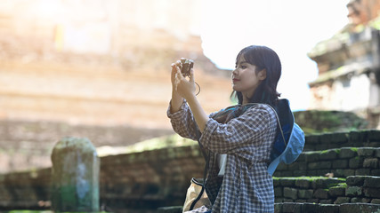Young woman take a picture with travel holiday concept.