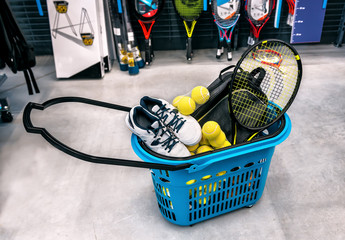 Poster basket with tennis sports goods