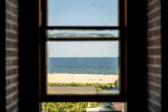 looking at the beach through the window