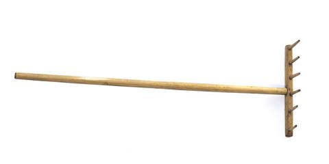 vintage wooden rural rake on a white background