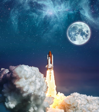 """Cloudy launch of rocket Space Shuttle into colorful starry outer space and the full moon. """"The elements of this image furnished by NASA"""""""