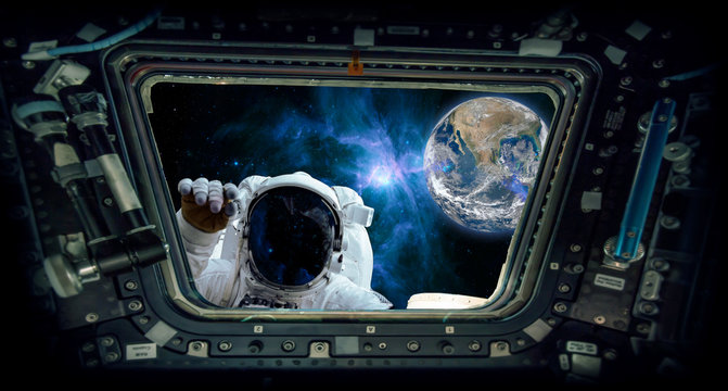 "astronaut knocking and the earth ""Elements of this image furnished by NASA"""