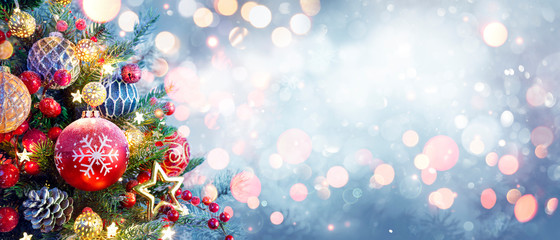 Christmas Tree With Ornament And Bokeh Lights In Snowy Background