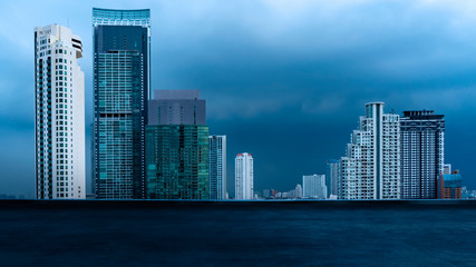 Fotomurales - Bangkok urban cityscape skyline night scene with empty loft cement floor on front.