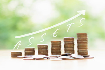 Money coins stack growing graph bank on nature background, saving finance and assets for wealth success, business concept.