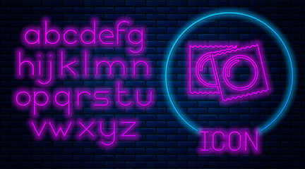 Glowing neon Condoms in package safe sex icon isolated on brick wall background. Safe love symbol. Contraceptive method for male. Neon light alphabet. Vector Illustration