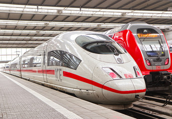 MUNICH, GERMANY - MAY 8, 2019 Munich central station departure and arrival hall, ICE Intercity-express train ready at the platform
