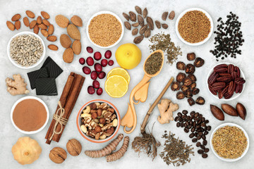Wall Murals Spices Herbal medicine and a variety of health foods for a healthy heart and cardiovascular system on marble background. Flat lay.