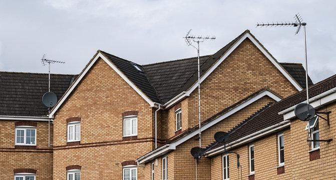 Generic new build housing estate rooftops.
