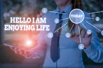 Writing note showing Hello I Am Enjoying Life. Business concept for Happy relaxed lifestyle Enjoy...
