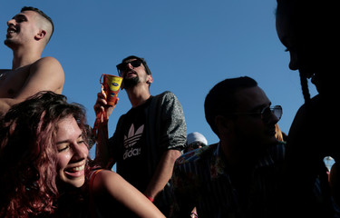 People cheer during the concert of Funk Orquestra at the Rock in Rio music festival in Rio de Janeiro