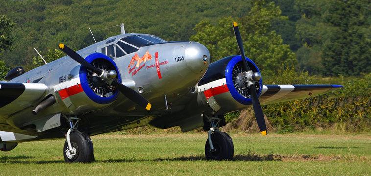 """Close up of Douglas Dakota aircraft  """" Good Vibrations"""" 1164 aircraft on airstrip."""
