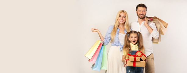 Family Holding Shopping Bags And Gifts On White Background, Panorama