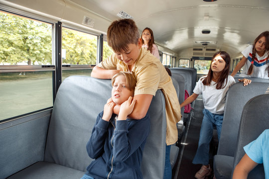 Classmates going to school by bus boy strangling kid violent