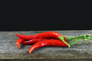 Canvas Prints Hot chili peppers ripe red hot chili pepper isolated in black background
