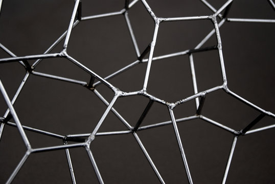 Connected Network of Welded Metal Pins resembling a Social Network