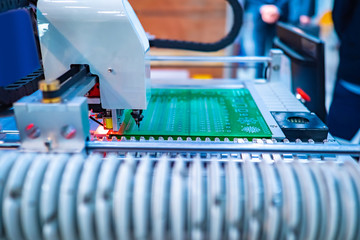 Automated production of printed circuit boards. The robot assembles the printed circuit Board according to a given program. Production of electronic components. Equipment of electrical laboratory.