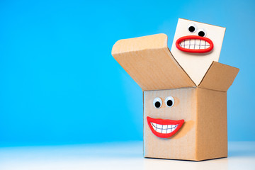 Emoji - packaging. Concept - Quality packaging of goods. Packing with emotions. Sale of packaging materials. Production of package materials. Boxes for Package. Packing with eyes and a smile.