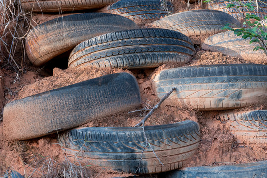 Controlling erosion with tires- close-up on tires in mud on a cliff