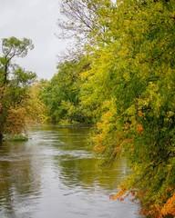Gentle river water flowing in Autumn