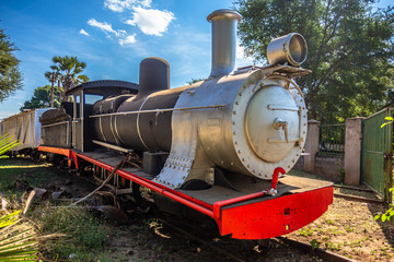 Old retro preserved locomotive train standing on the rails in Livingstone, Zambia