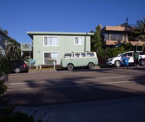 old vintage van mint green matches beach apartment