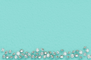 Round cut diamonds scattered on turquoise background