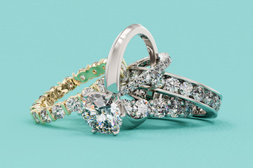 Interwoven diamond rings on turquoise background