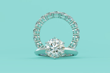Solitaire round cut diamond engagement ring, eternity ring on turquoise background