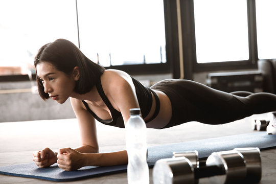 "Asian woman doing to ""plank"". excercise concept."