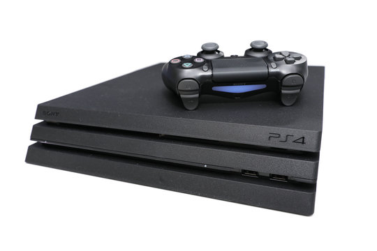 BANGKOK, THAILAND - JANUARY 15, 2017:The New Sony Dualshock Controller with PlayStation 4 Pro on January 15, 2017. in Bangkok Thailand.