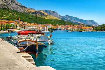 Harbor and moored touristic boats in Makarska resort, Dalmatia, Croatia Fototapete