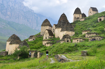 Nort Ossetia,  Russia, June, 23, 2019. Dargavs. City of the dead in cloudy summer day. Russia. North Ossetia