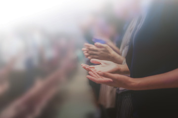 Soft focus of Christian worship with raised hand,m Fotomurales