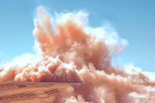 Dust clouds after the detonator blast in the desert