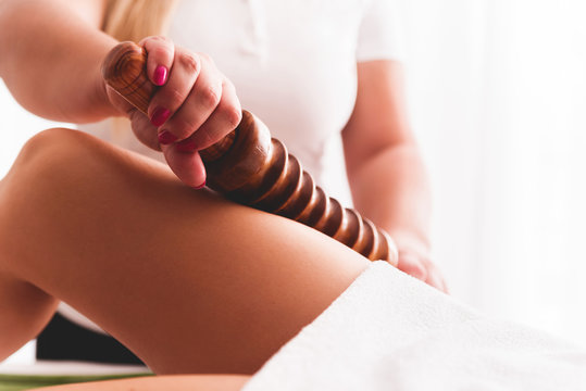 Maderotherapy anticellulite massage treatment of leg