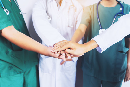 Doctor and nurse coordinate hands. Concept Teamwork, happy doctors working together as team for motivation, success medical health care