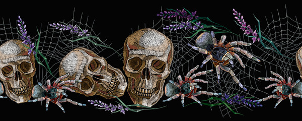 Halloween seamless pattern. Human skull, lavender flowers and spider. Embroidery style. Classical dark art gothic art. Medieval template for clothes, textiles