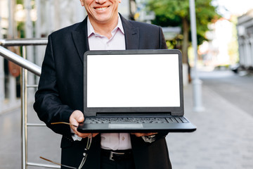 Cropping image of businessman holding open laptop, empty white blank screen- Image