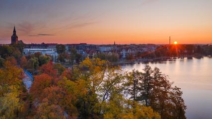 Sun just rises over autumn Elk. Masuria, Poland. Fototapete