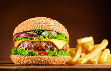 Fototapeta burger and french fries on wooden table obraz