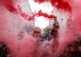 People attend a rally against approval of so-called Steinmeier Formula, in Kiev